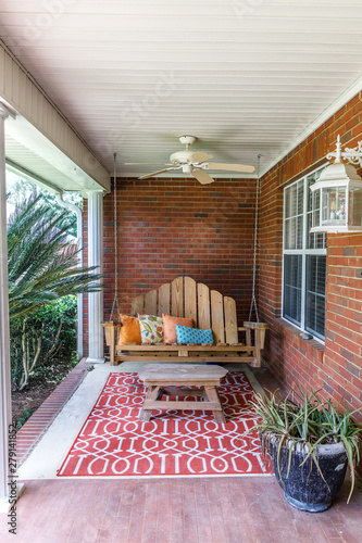 Colorful and modern bohemian boho outdoor front porch decoration with seating and a plant Canvas Print