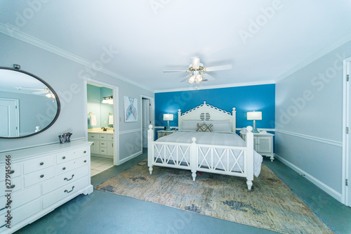Photo Blue and White Modern Bedroom with King Sized White Wood bed and accent table la