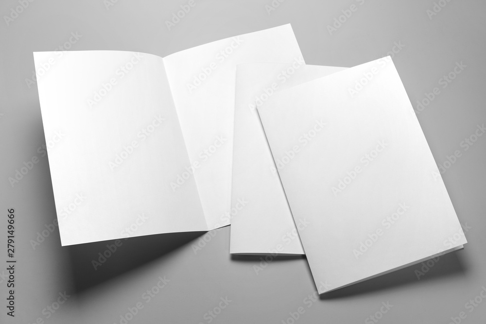 Fototapeta Blank half-folded booklet, postcard, flyer or brochure mockup template on gray background