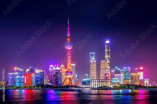 Deurstickers Violet Cityscape of Shanghai at twilight sunset. Panoramic view of Pudong business district skyline from the Bund.