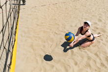 Catching The Ball In Volleyball. Taking In Volleyball. Young Girl Playing Beach Volleyball