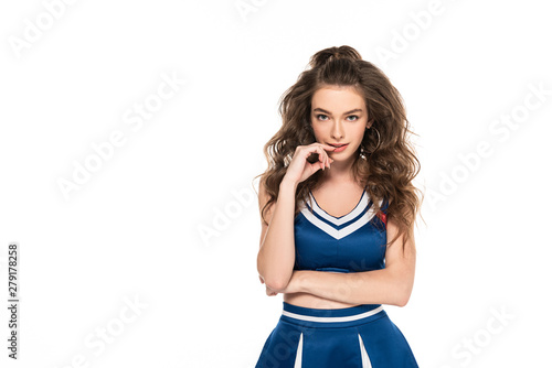 Fotografía  sexy seductive cheerleader girl in blue uniform touching lips isolated on white