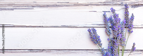 Summertime - lavender flowers. Bunch of lavender flowers on white rustic wooden background.