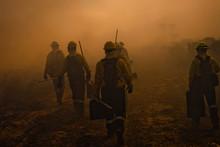 Wildland Firefighters Walking Through Smoke