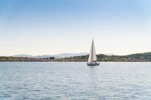 Lonely Yacht Sailing On Opened Sea Off The Coast Of Croatia