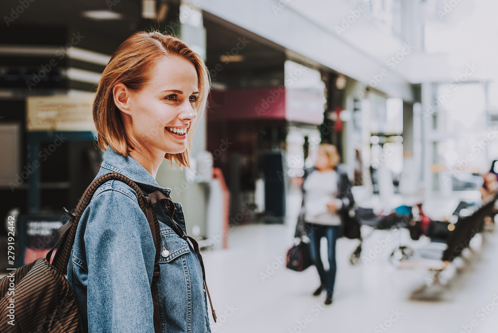 Fototapety, obrazy: Happy woman is situating in waitng area in airport