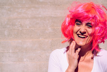 Slender And Ugly Woman With Colorful Wig Posing Ridiculously.