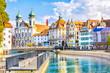 Leinwanddruck Bild - View of Jesuit Church from river Reuss in Lucerne city in Switzerland