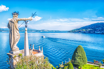 Beautiful Isola Bella island with flower garden and sculptures on Lake Lago Maggiore, Stresa, Italy
