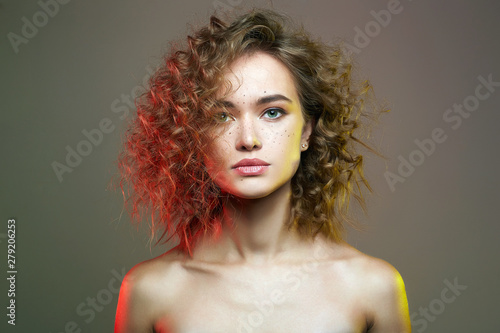 Recess Fitting Hair Salon Beautiful woman in colorful Lights. amazing curly girl
