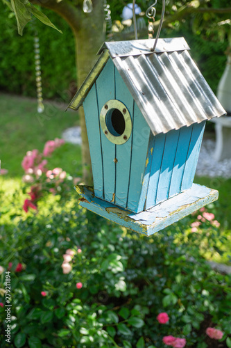 Canvas Blue birdhouse in the tree