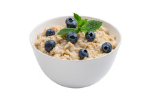 Oatmeal Porridge With Blueberries And Mint Isolated
