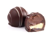 Dark Chocolate Truffles On A White Backgroun