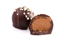 Salted Caramel Filled Dark Chocolate Truffles On A White Background