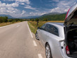 profesional DSLR camera on a tripod at asphalt road in beautiful countryside