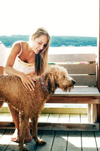 Woman Stroking Wet Dog