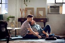 Couple Relaxing On Floor In Li...