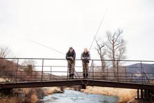 Couple Fishing Off Bridge Toge...