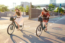 Smiling Friends Riding Bicycle On Street