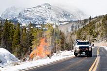 Truck Driving By Fire In Mount...