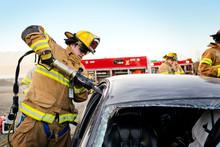 Firefighters Tending Damaged C...