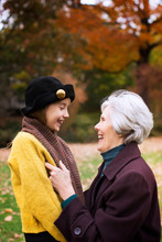 Grandmother With Granddaughter (8-9) In Park