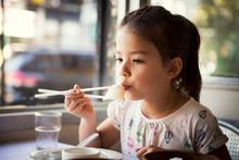 Girl Having Lunch In Restaurant