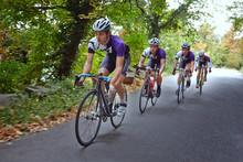 Group Of Cyclists Riding Down ...