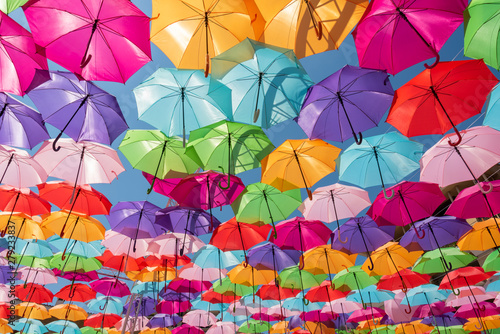 Fotografia  Street decoration colorful umbrellas background