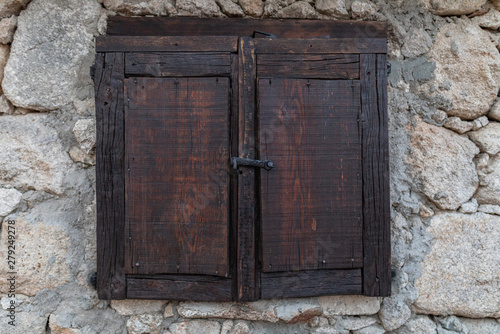 ancient wooden box on stone wall Wallpaper Mural