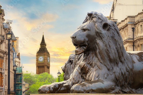 Garden Poster Lion Lion Sculpture at Trafalgar Square with Big Ben on the background in London, UK