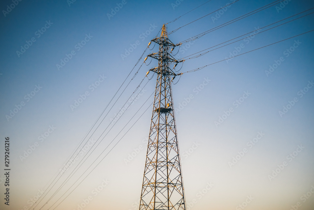 Fototapety, obrazy:  A tower in front of the sky divided into two colors