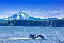 The Hovercraft On Pasific Ocean In Kamchatka Peninsula On The Background Volcano