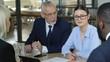 Entrepreneurs convincing partners to buy goods, business meeting, export deal