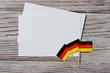 October 3, happy Day of German unity. the concept of patriotism , freedom and independence. Mini flags with a white card on wooden background
