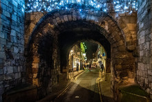 YORK, ENGLAND, DECEMBER 11, 2018: People Walking In The Beautiful Medieval Streets Of City Of York, United Kingdom, Surrounded By The Old City Wall