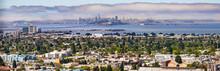 Panoramic View Of Berkeley; San Francisco, Treasure Island And The Bay Bridge Visible In The Background; California
