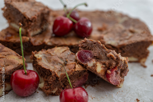 Chocolate brownie pieces decorated with cherry