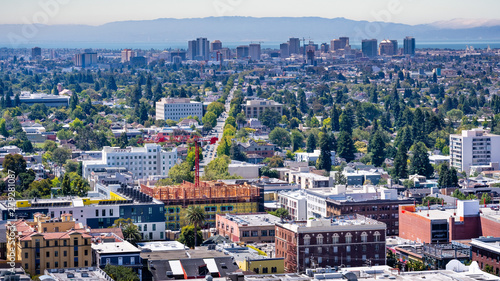 Leinwand Poster Aerial view of Berkeley and north Oakland on a sunny day; downtown Oakland in th