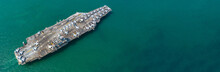 Aerial View American Navy Nuclear Aircraft Carrier View From Above, Military Army Navy Ship Carrier Airplane Full Loading Fighter Jet Aircraft, Copy Space. For Banner Web.
