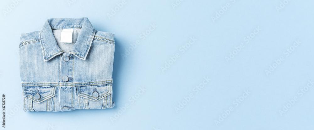 Fototapeta Jeans jacket on blue background
