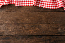 Red Checkered Tablecloth On Wooden Background. Top View