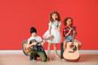 Leinwandbild Motiv Band of little musicians against color wall