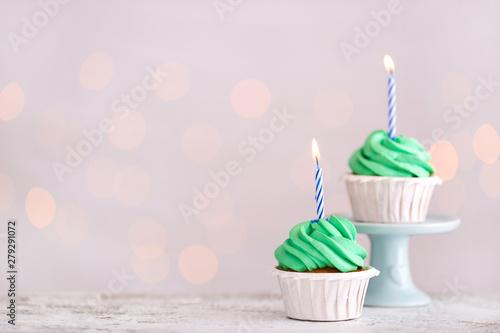 Tasty Birthday cupcakes against defocused lights Canvas Print