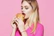 young woman eating hamburger
