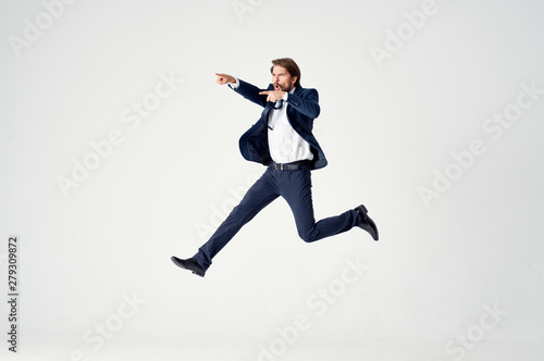 businessman jumping in the air Wallpaper Mural