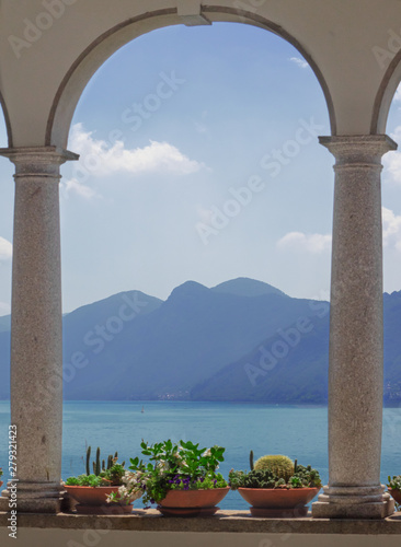 Fotobehang Meer / Vijver window with stone columns overlooking the lake and the mountains.Como Lake, Italy