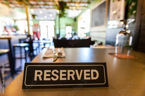Reserved sign on restaurant table Fototapeta