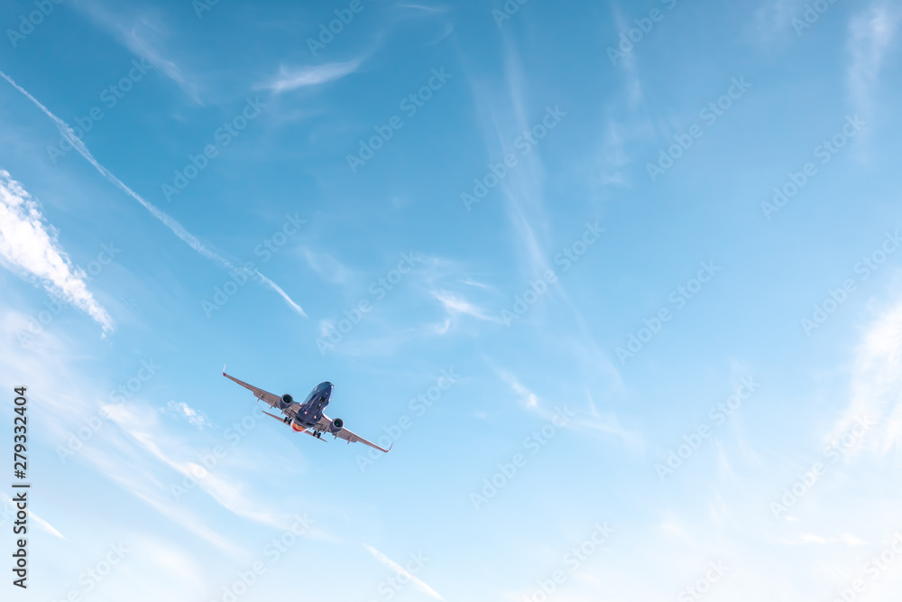 Fototapeta Aviation, travel, air transportation concept. Airplane in blue sky