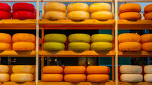 Dutch Cheeses, Edam, Gouda, Whole Round Wheels On Wooden Shelf, Cheese Store In Rotterdam, Netherlands